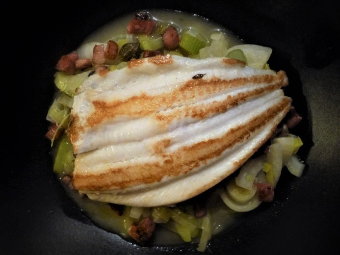 lemon sole on a pea and pancetta puree